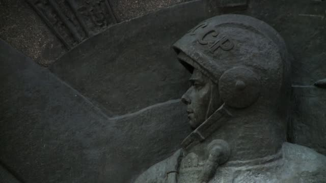 a bas-relief of an astronaut adorns the monument to the conquerors of space in moscow. available in hd. - monument stock videos & royalty-free footage