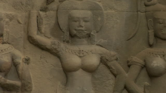 zo bas-relief of female figures at angkor wat / cambodia - female likeness stock videos & royalty-free footage