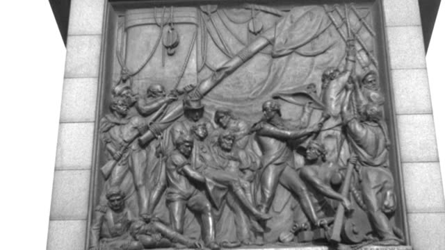 a bas-relief on nelson's  monument in london's trafalgar square depicts a heroic battle. - 1936 stock videos & royalty-free footage