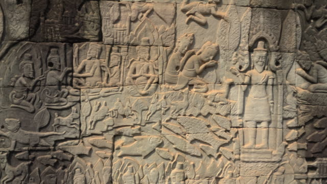 pan / bas-relief on wall at bayon temple - bas relief stock videos & royalty-free footage