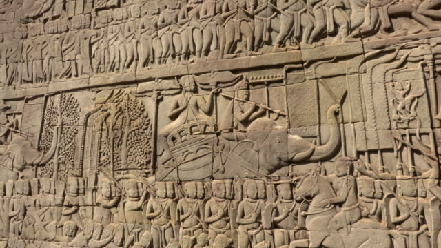 pan / bas-relief on wall at bayon temple - carving craft product stock videos & royalty-free footage