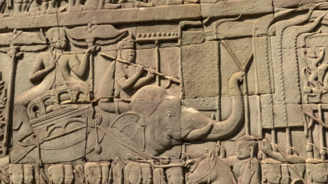 zi / bas-relief on wall at bayon temple - bas relief stock videos & royalty-free footage