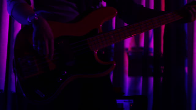 bass guitarist - string instrument stock videos and b-roll footage