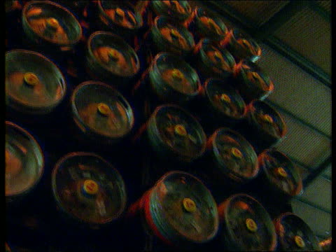 vídeos de stock, filmes e b-roll de bass redundancies england la stacked barrels of beer pan lr more ditto tilt down more ditto gv part of brewery with pipes and tx machinery pan rl... - baixo posição