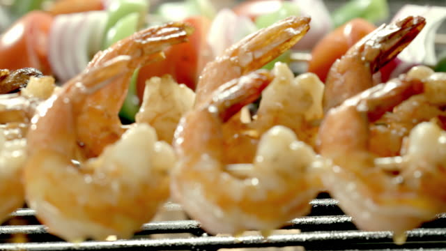 ecu basting brush swipes olive oil over shrimp on skewers on open flame grill - bbq brush stock videos and b-roll footage