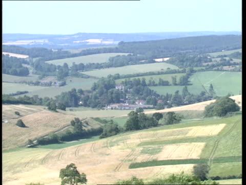 09 ext 2842 gvs hills and fields buildings of village amidst trees sheep tgv race track disused railway bridge amidst trees cr568 ends - tgv点の映像素材/bロール