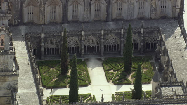 aerial ws batalha monastery courtyard / batalha, leria, portugal - circa 14th century stock videos & royalty-free footage