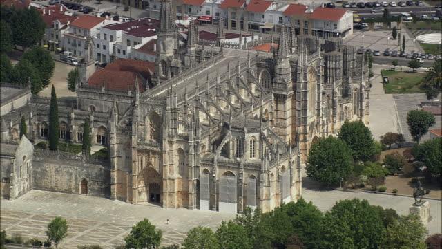 aerial ws batalha monastery exterior / batalha, leria, portugal - leiria district stock videos & royalty-free footage