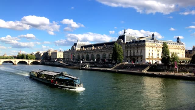 bateau mouche in front of orsay museum, paris france. - river seine stock videos & royalty-free footage