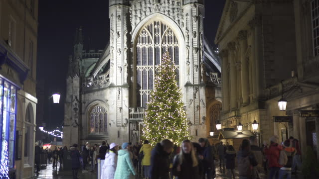 bath abbey illuminated at night at christmas - christmas decoration stock videos & royalty-free footage