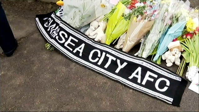 Tributes paid to 4 victims Swansea City AFC scarf and floral tributes