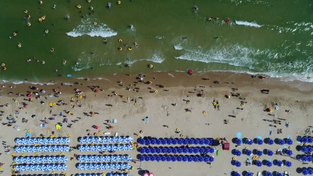 Bathers are seen on the beach and in the sea in this aerial video taken above Haeundae beach in Busan South Korea on Sunday July 16 2017