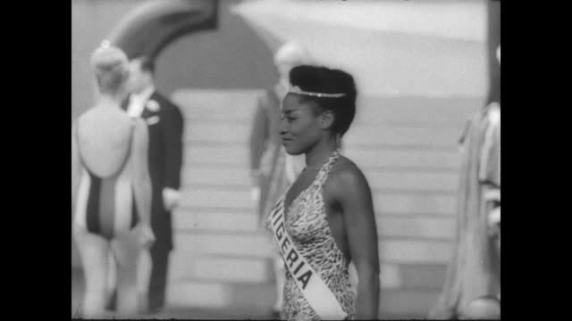 bathing suit section of miss world contest held in lyceum ballroom in london / judges seated in a row / miss holland poses / miss nigeria poses /... - miss world pageant stock videos & royalty-free footage