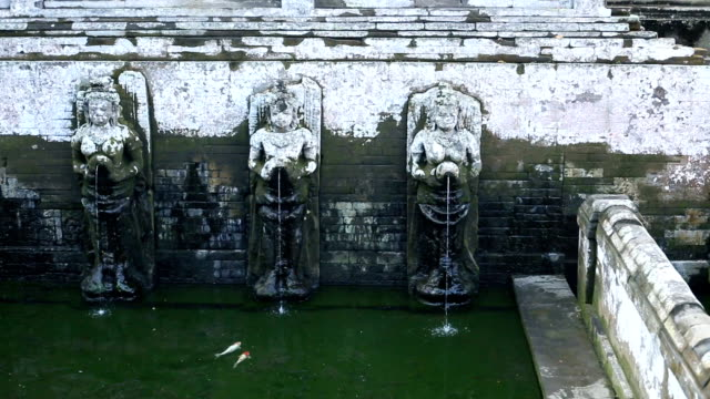 Bathing Temple Figures of the ancient temple of Pura Gua Gajah in Bali Island, Indonesia. Elephant Cave