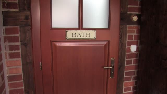 bathroom door - domestic bathroom stock videos & royalty-free footage