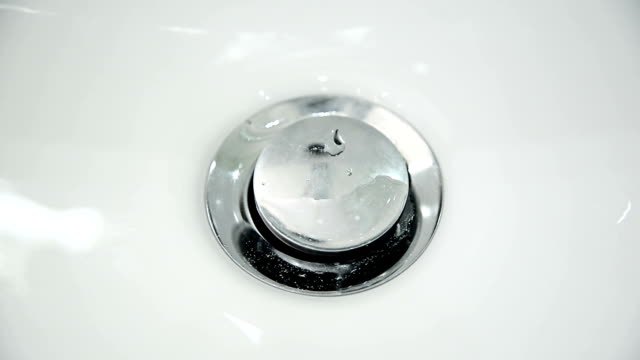 bathroom sink. close up - bathroom sink stock videos & royalty-free footage