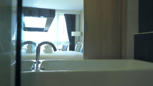bathtub decoration in bathroom interior - dolly shot stock videos & royalty-free footage