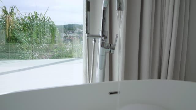 bathtub - bathroom stock videos & royalty-free footage