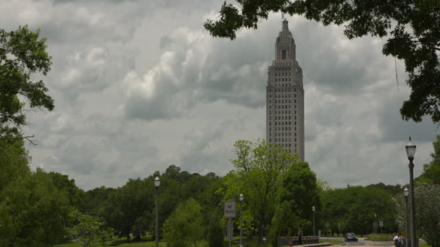 wgno baton rouge louisiana us louisiana state capitol against clouds on wednesday may 17 2017 - luisiana stock videos and b-roll footage