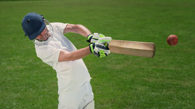 slo mo speed ramp batsman batting the ball in the sunny field - batsman stock videos & royalty-free footage