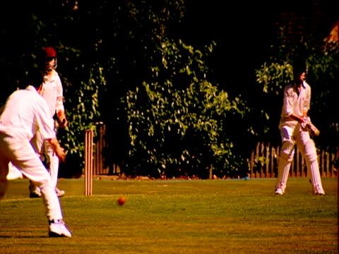 a batsman hits a ball during a cricket match. - batsman stock videos & royalty-free footage