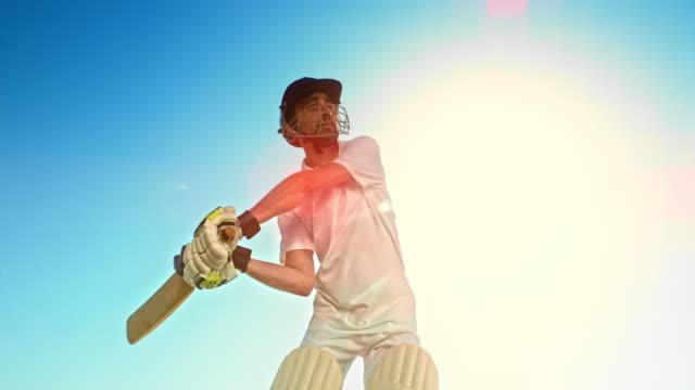 slo mo batsman hitting the ball with the cricket bat - batsman stock videos & royalty-free footage