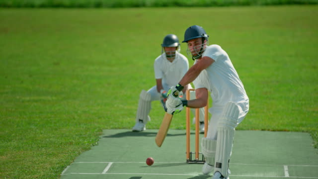 slo mo batsman missing the ball and wicket keeper catching it - cricket video stock e b–roll