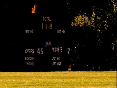 a batsman runs during a cricket game. - protective sportswear stock videos & royalty-free footage