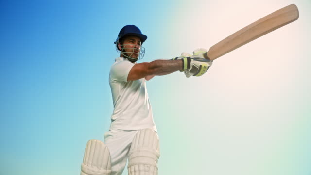 slo mo batsman striking the ball with the cricket bat - cricket ball stock videos & royalty-free footage