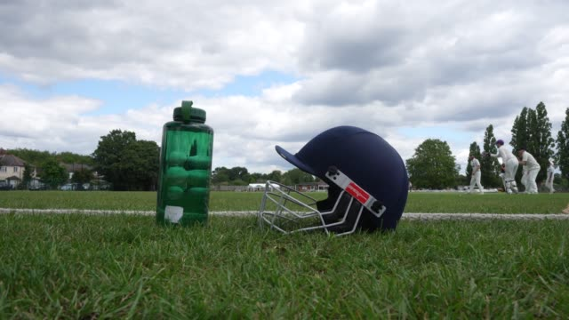 batsmans helmet at the side of the pitch at chiswick cricket club on july 11 2020 in london england the uk government has given the green light for... - sports helmet stock videos & royalty-free footage