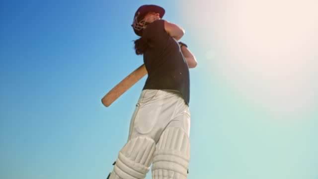 slo mo batswoman hitting the ball in sunshine - cricket video stock e b–roll