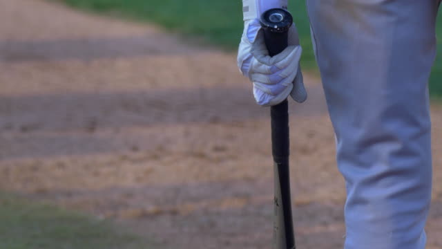 a batter at a baseball game prepares to swing the bat and hit the ball. - swing stock videos & royalty-free footage