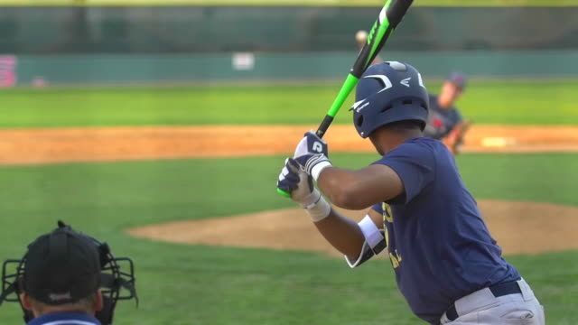 a batter at a baseball game prepares to swing the bat and hit the ball. - slow motion - baseball bat stock videos & royalty-free footage