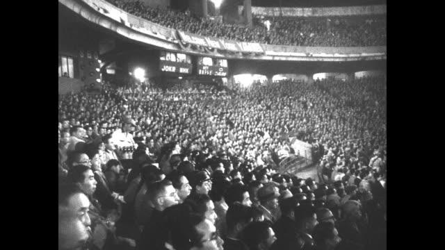 batter hits ball in baseball play / ws huge crowd in korakuen stadium can see japanese people sitting in bleachers / new york yankees stand in a line... - 1950点の映像素材/bロール