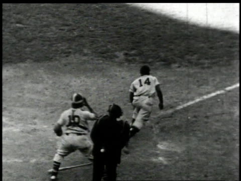 Batter hitting a ball and running to first base at a Negro League baseball game / United States