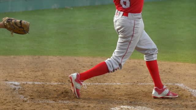 a batter makes a play at a baseball game. - slow motion - バッティング点の映像素材/bロール