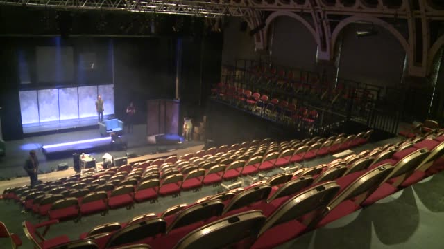 stockvideo's en b-roll-footage met battersea arts centre refurbishment england london wandsworth battersea battersea arts centre int sound engineer working in theatre / interiors of... - wandsworth