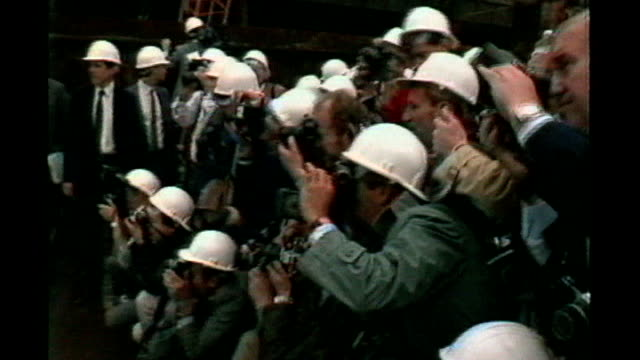 first homes to go on sale ulm2040 photographers wearing hard hats covering event where then prime minister margaret thatcher launched plans to turn... - バタシー発電所点の映像素材/bロール