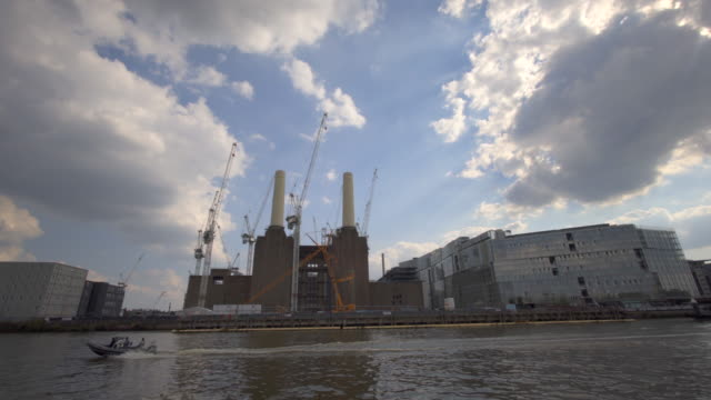 battersea power station under renovation into luxury apartment. - battersea stock videos & royalty-free footage