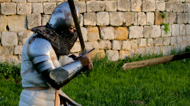 battle between two aggressive and strong opponents, medieval knights. - cavalleria video stock e b–roll