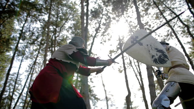 battle between two aggressive and strong opponents, medieval knights. - knights templar stock videos and b-roll footage