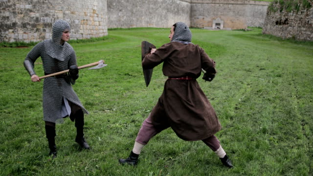 Battle between two aggressive and strong opponents, medieval knights.