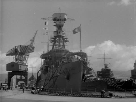 battle cruiser in pearl harbor dock xws pearl harbor w/ uss enterprise docked bg - anno 1941 video stock e b–roll
