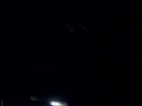 battle for kigali; itn rwanda: airport: un garrison: int tcms un soldier sitting on bed r-l another un garrison tms group of un soldiers sitting in... - キガリ点の映像素材/bロール