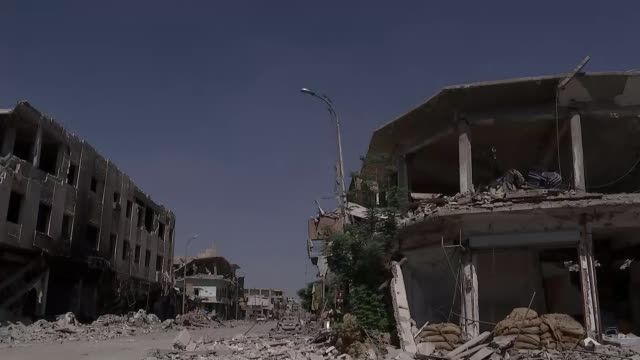 ITV News visits square where Islamic State carried out countless executions SYRIA Raqqa EXT GV street lined with bombdamaged buildings GV bombdamaged...