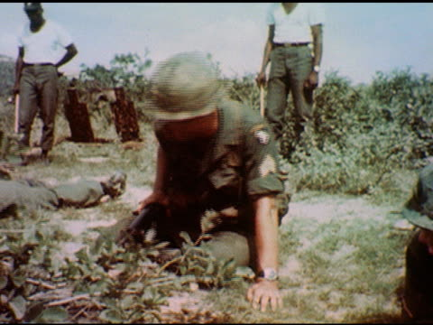 / battle line of soldiers move forward with guns aimed they suddenly drop to ground / officers inspect maneuver and position of lying men on january... - schlacht stock-videos und b-roll-filmmaterial