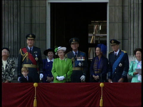 50th anniversary buckingham palace flypast **intermittent military music heard** windows of buckingham palace the queen and duke of edinburgh onto... - balkon stock-videos und b-roll-filmmaterial