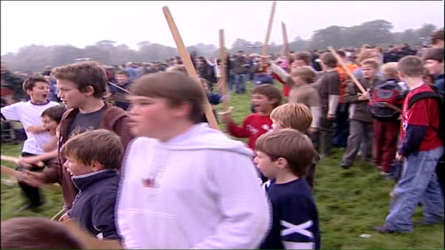 battle of hastings reenactment general views of kids playng at being in a battle with wooden sticks as swords and charging / general views of... - battle of hastings stock videos & royalty-free footage