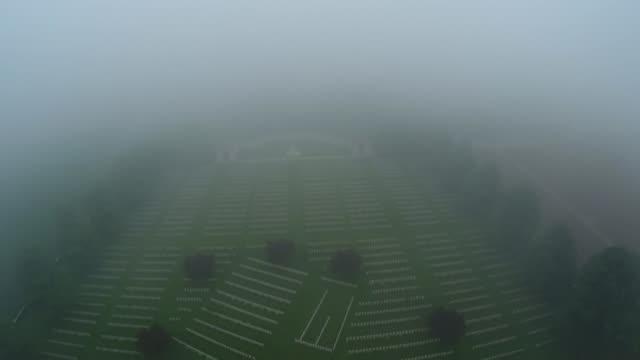 vídeos y material grabado en eventos de stock de battle of the somme centenary michael morpurgo reflects air view / aerial first world war cemetery seen through low clouds - michael morpurgo