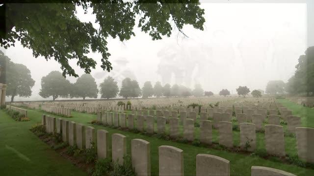 vídeos y material grabado en eventos de stock de battle of the somme centenary michael morpurgo reflects graves in war cemetery - michael morpurgo